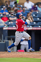 Jake Elmore (20) of the Buffalo Bisons follows through on his swing against the Durham Bulls at Durham Bulls Athletic Park on April 30, 2017 in Durham, North Carolina.  The Bisons defeated the Bulls 6-1.  (Brian Westerholt/Four Seam Images)
