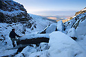 "20/01/16<br /> <br /> <br /> The view looking west over Kinder reservoir and towards Cheshire and Wales.<br /> <br /> Only 160 miles, as the crow flies from central London, Will Flanagan (36), explores the stunning icicles at Kinder Downfall near Hayfield in the Derbyshire Peak district today. After days of cold sub-zero temperatures the 100 ft waterfall finally froze over last night.<br /> <br /> Will said: ""I had to set off at dawn to to get up here. I've been watching the overnight temperatures and thought there's be a chance it would be frozen today. <br /> <br /> ""As the sun began to rise the ice started to melt. I could here it cracking beneath my feet and I saw a few giant icicles crash down. So I didn't stay up there very long!<br /> <br /> ""I definitely wouldn't have wanted to climb any higher up it today even if I'd had ropes with me - the ice wouldn't have been strong enough to support me. If I'd have arrived any later I wouldn't have risked going all the way up. <br /> <br /> ""But all the same it was an awesome spectacle and one of the most extreme walks I've ever done.""<br /> <br /> The waterfall flows from Kinder Scout the only mountain in the Derbyshire Peak District between Hayfield and Edale. <br /> <br /> All Rights Reserved: F Stop Press Ltd. +44(0)1335 418365   www.fstoppress.com."