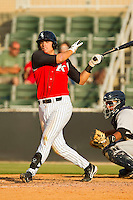 Grant Buckner #14 of the Kannapolis Intimidators follows through on his swing against the Lexington Legends at CMC-Northeast Stadium on May 20, 2012 in Kannapolis, North Carolina.  The Legends defeated the Intimidators 7-1.  (Brian Westerholt/Four Seam Images)