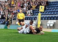 High Wycombe, England. Tom Varndell of London Wasps scores a try during the Aviva Premiership match between London Wasps and London Irish at Adams Park on September,15 2012 in High Wycombe, England.