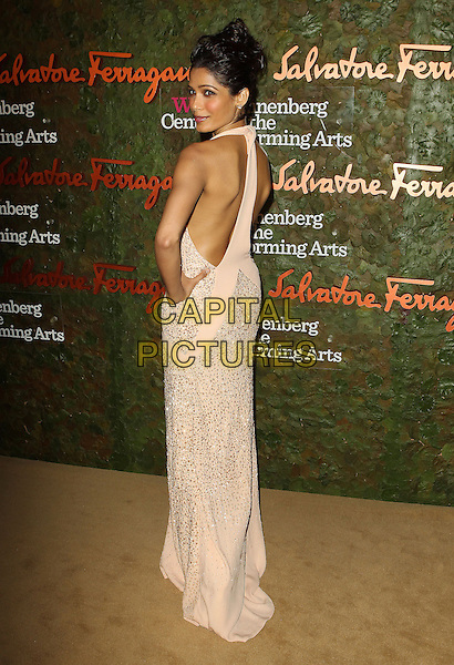 Freida Pinto<br /> Wallis Annenberg Center For The Performing Arts Inaugural Gala held at Wallis Annenberg Center For The Performing Arts,  Beverly Hills, California, USA, 17th October 2013.<br /> full length beige cream long maxi dress sleeveless beaded hand on hip nude back rear behind over shoulder <br /> CAP/ADM/KB<br /> &copy;Kevan Brooks/AdMedia/Capital Pictures