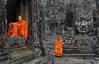 Monks at Bayon Temple, Angkor, Cambodia. The Khmer Rouge killed more than two million monks, doctors, artists, judges, teachers, musicians-anyone with an education. In 1991, after twenty-five years of genocide and civil war, an international peace treaty was finally signed to create a free democratic nation.