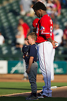 Texas Rangers pitcher Neftali Feliz #58 listens to the National Anthem before his rehab start with the Pacific Coast League Round Rock Express. Feliz pitched 1.2 innings against Omaha Storm Chasers on July 20, 2012 at the Dell Diamond in Round Rock, Texas. The Chasers defeated the Express 10-4. (Andrew Woolley/Four Seam Images)
