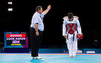 04 DEC 2011 - LONDON, GBR - Aaron Cook (GBR) (in red) is declared winner of the men's -80kg category after his opponent, Ramin Azizov (AZE), was unable to contest the final of the London International Taekwondo Invitational and 2012 Olympic Games test event at the ExCel Exhibition Centre in London, Great Britain .(PHOTO (C) NIGEL FARROW)