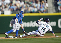 04 October 2009: Seattle Mariners #16 Josh Wilson slides in safely at second base under the tag of Texas Rangers second baseman Ian Kinsler. Seattle won 4-3 over the Texas Rangers at Safeco Field in Seattle, Washington.
