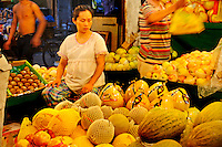 Pregnant woman selling fruit at a shop on Dajing Lu market in Shanghai's old Chinese city, one of the city's oldest and busiest wet markets.