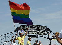 "FRESNO,CA - May 30,2009: Cheering as marchers arrive in downtown Fresno, Chip Garcia-Coakley, with flag, joins other activists representing Gay Rights Movement, as they cheer the arrival of marchers from Selma, CA to Fresno, CA, May 30, 2009. The group joined a rally at Fresno City hall. Gay rights activists are converging on Fresno today for a rally called "" Meet in the middle 4 equality."""