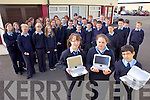 HIGH TECH: Students who began first year at St Joseph's Secondary School in Ballybunion on Friday with their new Fizzbooks, including front l-r: Clodagh Mason, Ellis Barry, Joshua Reay.