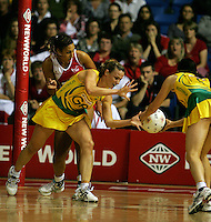 16.11.2007 Australian Sharelle McMahon and Natalie von Bertouch and England's Geva Mentor in action during the Australia v England match at the New World Netball World Champs held at Trusts Stadium Auckland New Zealand. Mandatory Photo Credit ©Michael Bradley.