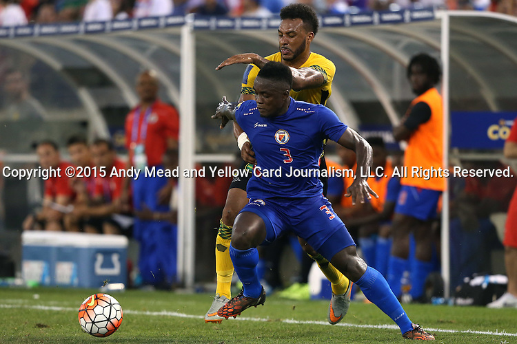18 July 2015: Mechak Jerome (HAI) (3) and Giles Barnes (JAM) (behind). The Jamaica Men's National Team played the Haiti Men's National Team at M&T Bank Stadium in Baltimore, Maryland in a 2015 CONCACAF Gold Cup quarterfinal match. Jamaica won the game 1-0.