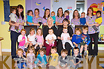 Siobhan Carmody seated centre with her staff and some of the young children they look after at Bellview Woods Childcare in Fossa Killarney