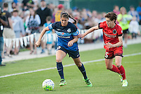 Kansas City, Mo. - Saturday April 23, 2016: FC Kansas City defender Brittany Taylor (13) and Portland Thorns FC defender Meghan Klingenberg (25) fight for possession during a match at Swope Soccer Village. The match ended in a 1-1 draw.