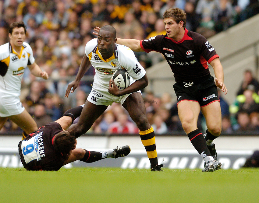 Photo: Leigh Quinnell..Saracens v London Wasps. Guinness Premiership. 02/09/2006. Ayoola Erinle skips through the Saracens defence.