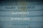 Gary Chabot shipwrights boatbuilders shed door Newhaven, East Sussex, England
