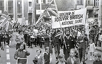 National Front march, from Tennant Street to Royal Avenue, Belfast, N Ireland, 27th July 1974, is headed by Councillor Michael Brooks, bearded and carrying a Union Jack flag. Brooks is a member of Castlereagh Borough Council. The purpose of the march was to protest about a Terrorism (or Terrorist?} Convention being held in Belfast 29th July to 2nd August. 197707270412<br />