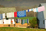 Clothesline on Amish farm with blue star quilt.