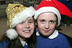 Jane Ashe and Jessica Murray at the Christmas Carol Singing with Mell National School...Photo NEWSFILE/Jenny Matthews.(Photo credit should read Jenny Matthews/NEWSFILE)....This Picture has been sent you under the condtions enclosed by:.Newsfile Ltd..The Studio,.Millmount Abbey,.Drogheda,.Co Meath..Ireland..Tel: +353(0)41-9871240.Fax: +353(0)41-9871260.GSM: +353(0)86-2500958.email: pictures@newsfile.ie.www.newsfile.ie.FTP: 193.120.102.198.