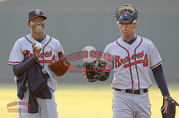 RHP Juilo Teheran, left, and catcher Christian Bethancourt, two of the Atlanta Braves' top prospects, walk toward the bullpen before playing in a game against the Greenville Drive April 14, 2010, at Fluor Field at the West End in Greenville, S.C. Photo by: Tom Priddy/Four Seam Images
