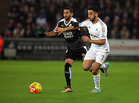 (L-R) Riyad Mahrez of Leicester City challenging \Neil Taylor of Swansea during the Barclays Premier League match between Swansea City and Leicester City at the Liberty Stadium, Swansea on December 05 2015