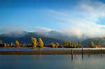 Idaho, North, Clark Fork. Mists over the Cabinet Mountains as morning light illuminates the cottonwoods along the Clark Fork River in autumn.