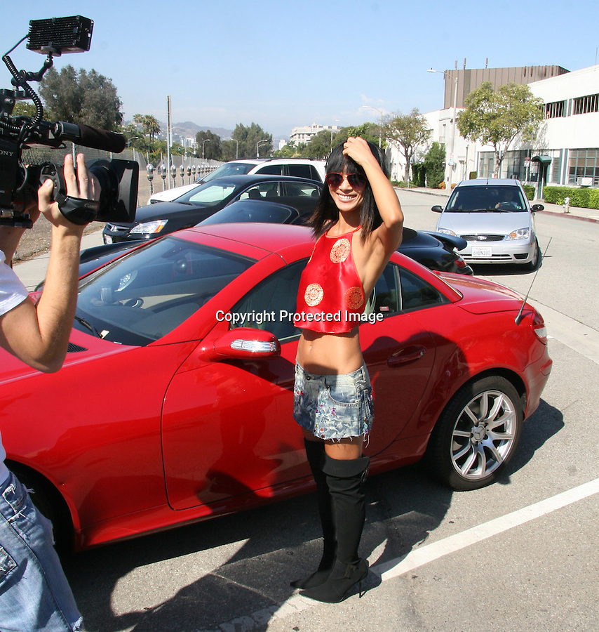 7-22-09..Bai Ling filming a reality tv show for Germany as she leaves the Neil George salon in Beverly Hills ca. Ling was dancing around, posing like a call girl & tying the laces on her stripper boots showing off her panther tiger tattoo on her back & Red Mercedes ....AbilityFilms@yahoo.com.805-427-3519.www.AbilityFilms.com