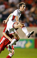 New England Revolution midfielder Steve Ralston (14) jumps to receive the ball.  The Chicago Fire defeated the New England Revolution 2-1 in the quarterfinals of the U.S. Open Cup at Toyota Park in Bridgeview, IL on August 23, 2006...