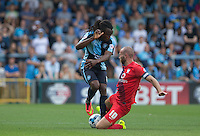 Russell Penn of York City slides into Marcus Bean of Wycombe Wanderers during the Sky Bet League 2 match between Wycombe Wanderers and York City at Adams Park, High Wycombe, England on 8 August 2015. Photo by Andy Rowland.