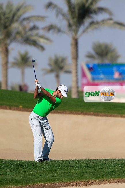 Alejandro CANIZARES (ESP) plays his 2nd shot from a fairway bunker on the 10th hole during Thursday's Round 2 of the 2015 Commercial Bank Qatar Masters held at Doha Golf Club, Doha, Qatar.: Picture Eoin Clarke, www.golffile.ie: 1/22/2015