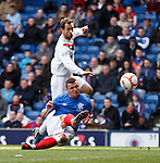 Lee McCulloch gets to the ball first to knock in the opening goal for Rangers after the keeper spills it