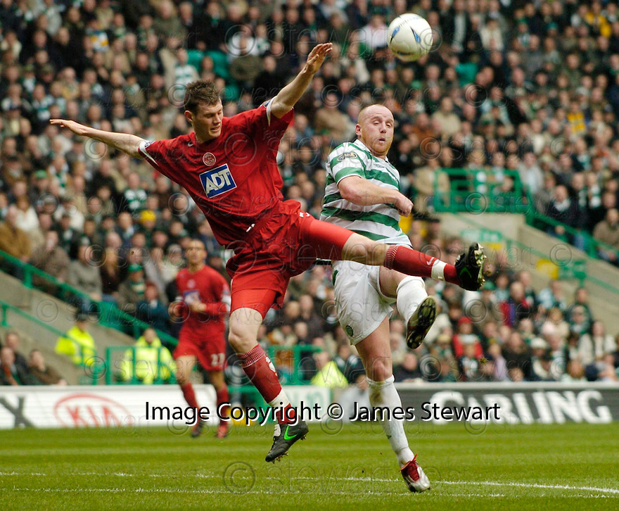 16/04/2005         Copyright Pic : James Stewart.File Name : jspa08_celtic_v_aberdeen.ALEXANDER DIAMOND AND JOHN HARTSON CHALLENGE FOR THE BALL...... Payments to :.James Stewart Photo Agency 19 Carronlea Drive, Falkirk. FK2 8DN      Vat Reg No. 607 6932 25.Office     : +44 (0)1324 570906     .Mobile   : +44 (0)7721 416997.Fax         : +44 (0)1324 570906.E-mail  :  jim@jspa.co.uk.If you require further information then contact Jim Stewart on any of the numbers above.........A