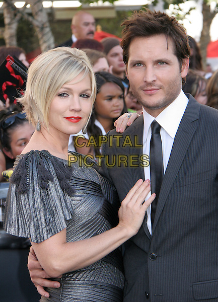 "JENNIE GARTH & PETER FACINELLI .attends the 2010 Los Angeles Film Festival Premiere of ""The Twilight Saga: Eclipse"" at the Nokia Theatre L.A. Live, Los Angeles, CA, USA, June 24th, 2010..half length dress suit tie married husband wife red lipstick grey gray .CAP/LNC/KR.©Kuroda/LNC/Capital Pictures."