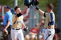 Mount St. Mary's Mountaineers Ryan Fisher (44) is congratulated by Ryan Haddaway (29) after hitting a home run during a game against the Ball State Cardinals on March 9, 2019 at North Charlotte Regional Park in Port Charlotte, Florida.  Ball State defeated Mount St. Mary's 12-9.  (Mike Janes/Four Seam Images)
