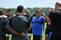 First team coach Toby Booth speaks to his players. Bath Rugby pre-season training session on July 18, 2014 at Farleigh House in Bath, England. Photo by: Patrick Khachfe/Onside Images