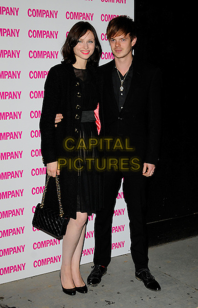 SOPHIE ELLIS BEXTOR & RICHARD JONES.Company magazine's 30th Birthday Party at Proud Galleries, Camden, London, England, UK, .October 1st 2008 .full length black sheer dress see through layered coat bag shoes Chanel husband wife couple Ellis-Bextor.CAP/CAN.©Can Nguyen/Capital Pictures.