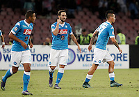 Calcio, Serie A: Napoli vs Juventus. Napoli, stadio San Paolo, 26 settembre 2015. <br /> Napoli&rsquo;s Gonzalo Higuain, center, celebrates with teammates after scoring during the Italian Serie A football match between Napoli and Juventus at Naple's San Paolo stadium, 26 September 2015.<br /> UPDATE IMAGES PRESS/Isabella Bonotto