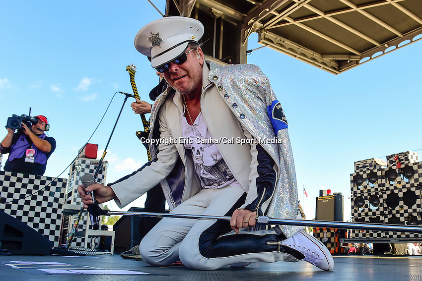 Sunday, September 25, 2016: Robin Zander of Cheap Trick performs for spectators before the NASCAR Sprint Cup Series Bad Boy Off Road 300 race held at the New Hampshire Motor Speedway in Loudon, New Hampshire. Sprint Cup Series driver Kevin Harvick (4) won the race. Eric Canha/CSM