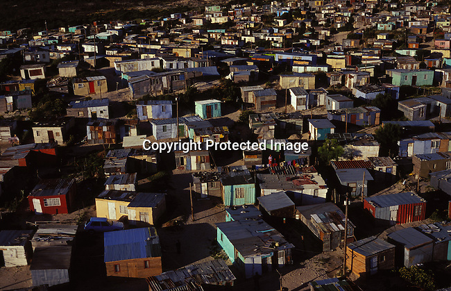 ditown00254.Digital. Townships. An aerial view of one of the poorest parts of Khayelitsha, SA on October 25 2003, where many newly arrived families live. People started moving into this township in 1984 and people are arriving every day from rural areas in the Eastern Cape looking for work in Cape Town. Poverty, shacks, densely populated. .©Per-Anders Pettersson/ iAfrika Photos