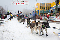 Cindy Gallea and team leave the ceremonial start line at 4th Avenue and D street in downtown Anchorage during the 2013 Iditarod race. Photo by Jim R. Kohl/IditarodPhotos.com