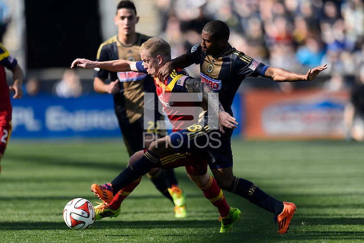 Luke Mulholland (19) of Real Salt Lake and Raymon Gaddis (28) of the Philadelphia Union during a Major League Soccer (MLS) match at PPL Park in Chester, PA, on April 12, 2014.