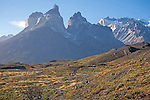 Hikers below Majestic Los Cuernos Towers in Torres del Paine National Park in Patagonia Chile