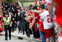 Ohio State Buckeyes head coach Urban Meyer high fives fans as he leads the team to St. John Arena for the Skull Session before the college football game between the Ohio State Buckeyes and the Northern Illinois Huskies at Ohio Stadium in Columbus, Saturday afternoon, September 19, 2015. (The Columbus Dispatch / Eamon Queeney)