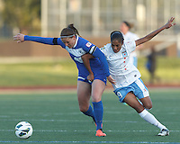 Boston Breakers defender Cat Whitehill (4) attempts to control the ball as Chicago Red Stars forward Maribel Dominguez (9) defends grabbing a fistful of jersey. In a National Women's Soccer League Elite (NWSL) match, the Boston Breakers (blue) defeated Chicago Red Stars (white), 4-1, at Dilboy Stadium on May 4, 2013.