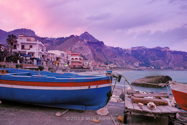 Boats and seashore just south of Taormina Sicily, Italy on the Mediterranean Sea.  Near the Train station in Villagonia.