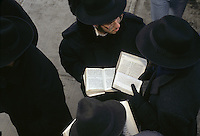 Beooklyn, NY - 1 March 1994 - Rabinical students pray from outside Lubavitcher Headquarters in Crown Heights.