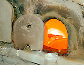 Murano, Italy - March 25, 2006 -- A view into a blast furnace used to melt sand to make glass at a factory in Murano, Italy on March 25, 2006..Credit: Ron Sachs / CNP
