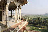 Agra, Uttar Pradesh, India. The Mughal Red Fort of Agra, where the emperor Shah Jahan was imprisoned by his son Aurangzeb. View over the river valley to Taj Mahal from the octagonal Musamman Burj tower, where Shah Jahan spent his last days.