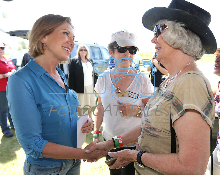 Republican presidential candidate Carly Fiorina, left, talks with Sandy Markoe, center, and Mary Burgoon at the Inaugural Basque Fry GOP event in Gardnerville, Nev., on Wednesday, Aug. 12, 2015. <br /> Photo by Cathleen Allison
