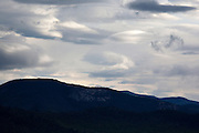 Storm clouds fill the sky from Bear Notch Road in Bartlett, New Hampshire USA. Bear Notch Road is a scenic byway.  Much of the this road (on the Bartlett side) follows the old Bartlett and Albany Railroad, which was a logging railroad in operation from 1887 - 1894