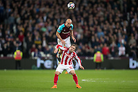 Pablo Zabaleta of West Ham United rises above Xherdan Shaqiri of Stoke City during the Premier League match between West Ham United and Stoke City at the Olympic Park, London, England on 16 April 2018. Photo by Andy Rowland.