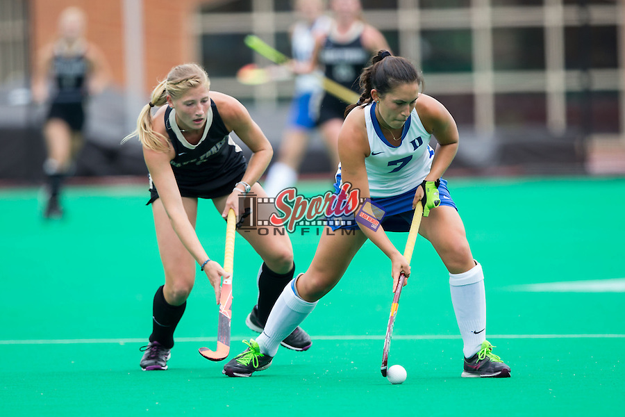Amanda Kim (7) of the Duke Blue Devils tries to keep the ball away from Jess Newak (3) of the Wake Forest Demon Deacons at Kentner Stadium on September 14, 2014 in Winston-Salem, North Carolina.  The Demon Blue Devils defeated the Demon Deacons 2-1.  (Brian Westerholt/Sports On Film)